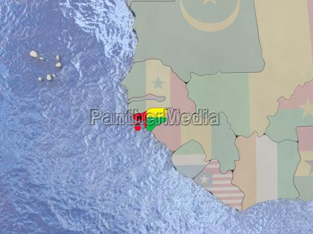 guinea bissau with flag on globe