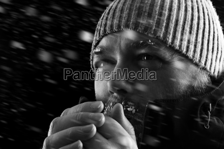 man freezing in snow storm bw