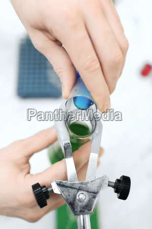 close up of scientist filling test