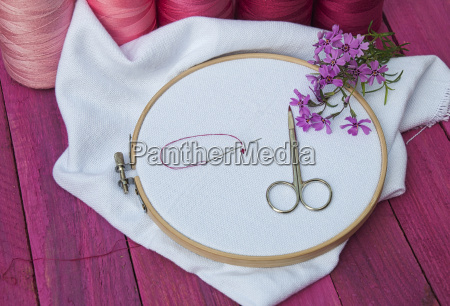 pink thread and white fabric in