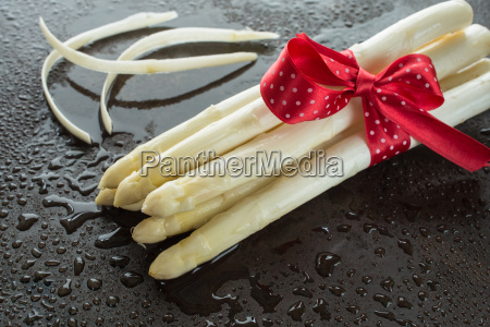 rod white asparagus with a red