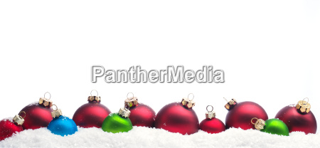 colorful christmas baubles in snow