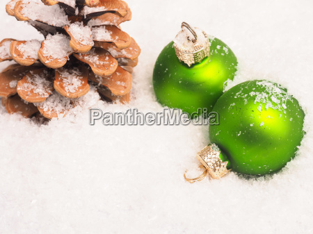 green vintage christmas baubles in snow