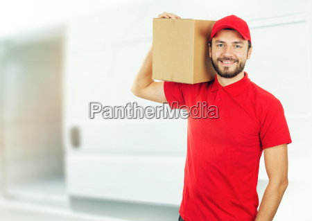 happy delivery man with box on