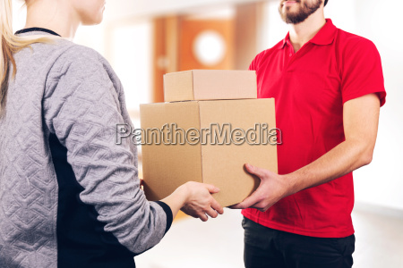 woman accepting a delivery of boxes