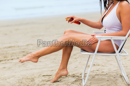 close up of woman sunbathing on