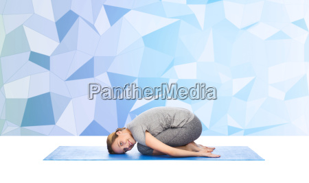 happy woman making yoga in child