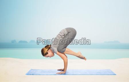 woman making yoga in crane pose