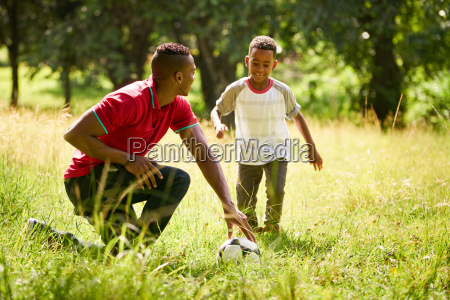 sport practice with father teaching son