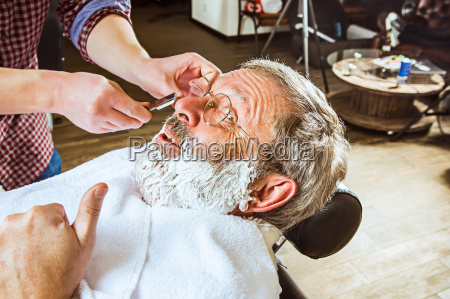 the senior man visiting hairstylist in