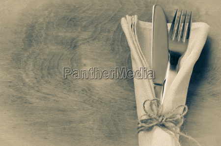 knife tied on white napkin with