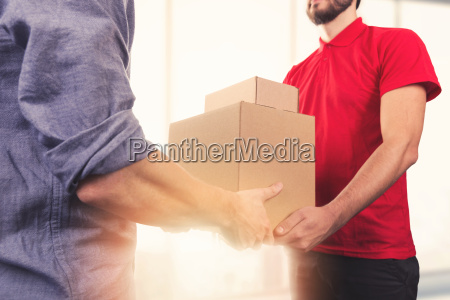 man accepting a delivery of boxes