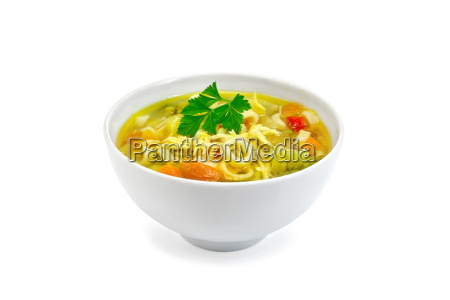 soup minestrone with parsley in white