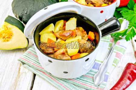 roast meat and vegetables in white