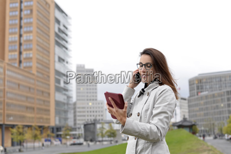 businesswoman with smartphone and digital tablet