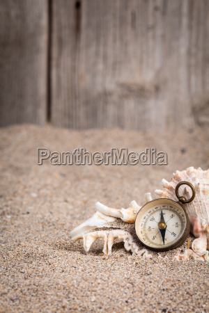 vintage compass with wooden fence and