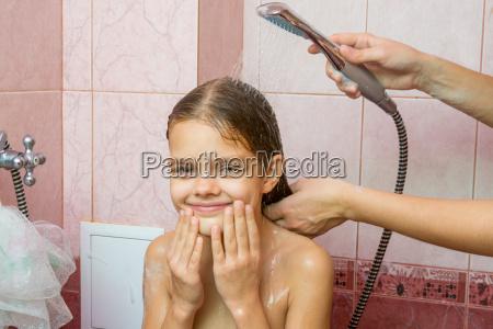 seven year girl bathe in a