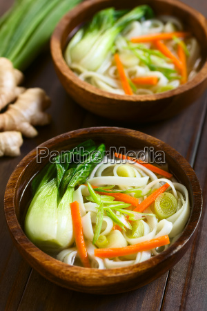 asian rice noodle soup with vegetables