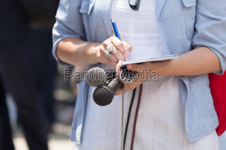female reporter at press conference