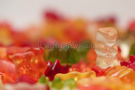 colorful gummy bears lie on a