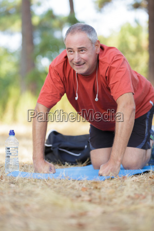 young retired man training in the