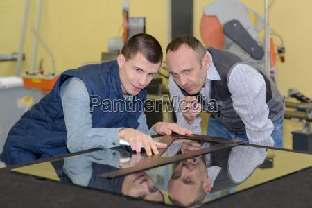 apprentice and teacher glazier in the