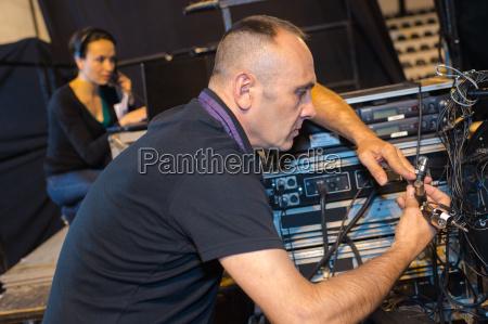 sound man setting up equipment