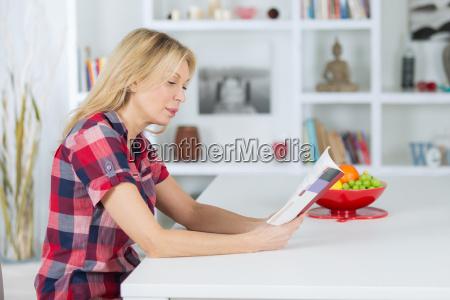 senior woman reading a book at