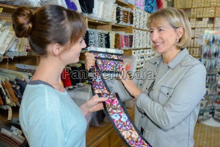 woman looking at floral ribbon