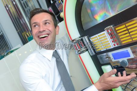 young man playing a slot machine