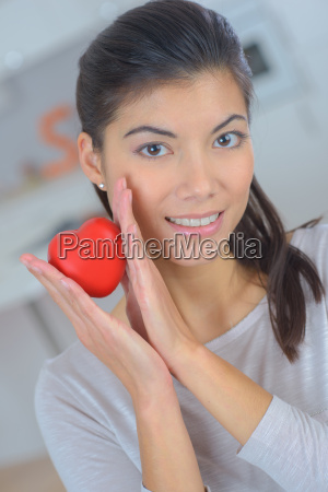 love woman smiling holding a red