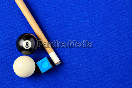 billiard balls cue and chalk in