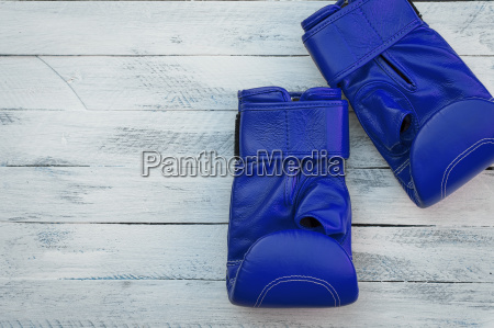 pair of blue boxing gloves on