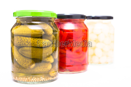 gherkins peppers and onions in glass