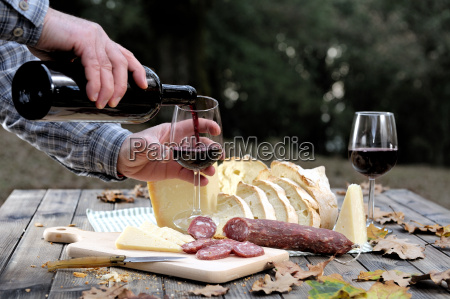 outdoor eating with bread cheese sausage