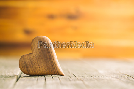 wooden heart on wooden table