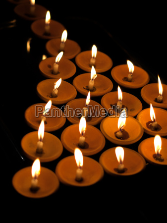offering lit candles