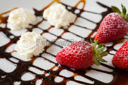 close up of strawberries and whipped