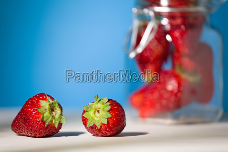 close up of two strawberries on