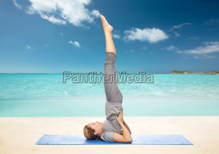 woman making yoga in shoulderstand pose