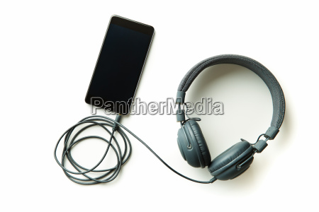 gray vintage headphones and cellphone