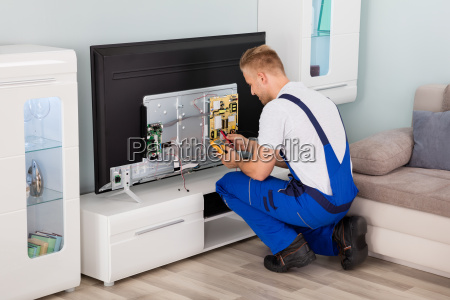 electrician checking television