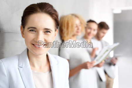 beautiful young buisinesswoman smile to colleagues