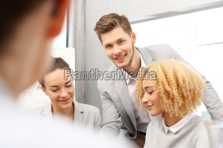 the team of employees discusses business