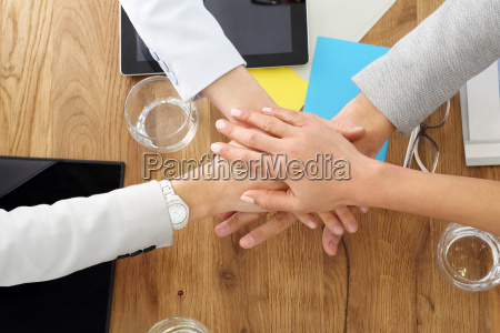 teamwork business success hands of four