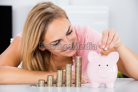 happy woman inserting coin in the