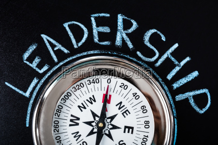 compass with leadership text