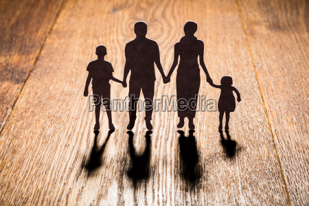 family papercut on wooden desk