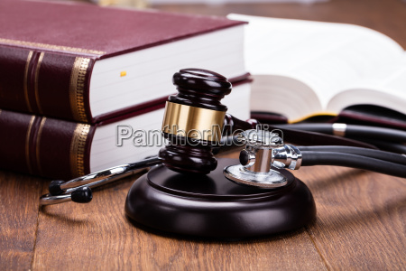 gavel with medical stethoscope