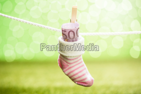 baby sock with dollar hanging on